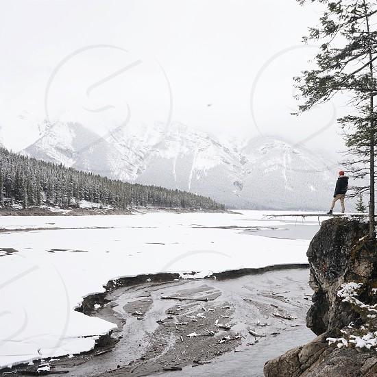 man standing on rock photo