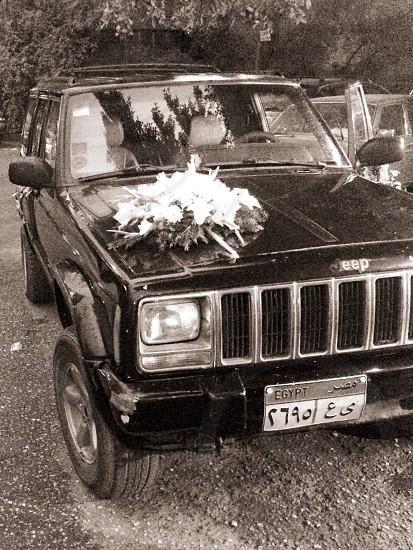 Wedding day; car; flowers; decoration; street; day photo