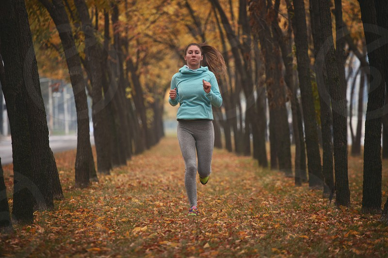 Jogging woman running in park photo