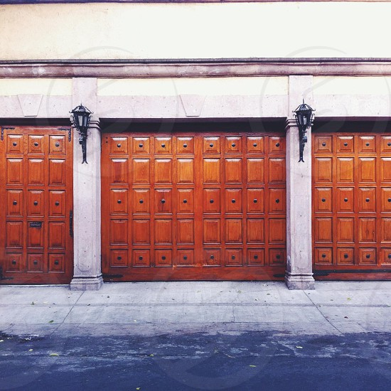 A wooden door. Elegant gate. Street.  photo