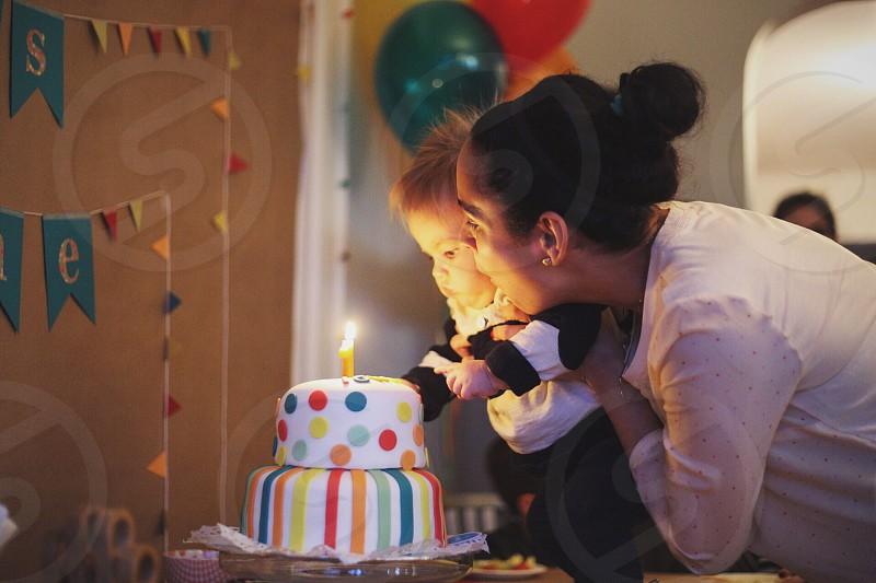 Mom baby son birthday cake candles joy love photo