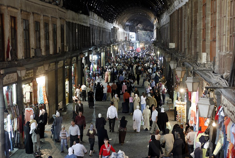 shops in the market or souq in the old town in the city of Damaskus in Syria in the middle east photo