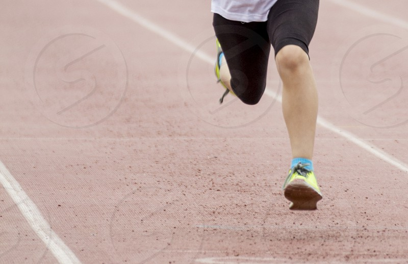 Legs moving during a sports competition of racing. photo