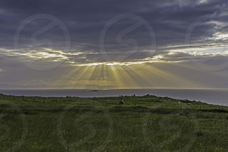 Crepuscular Rays Isle of Skye. photo