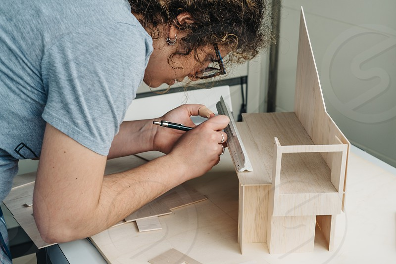 Woman architecture student working on models. Close up photo