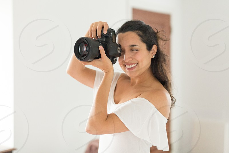 A job editorial of a photographer working in a studio. photo