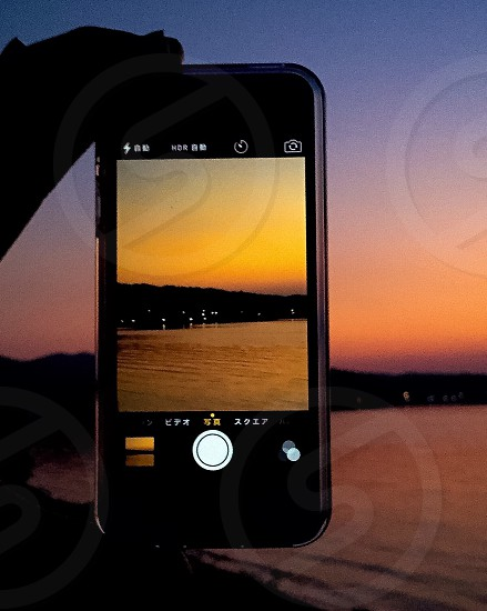 silhouette image of iphone taking picture photo