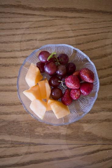 fruit fruit bowl grapes strawberries cantaloupe  photo