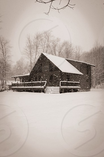 Winter time. Log cabin in central New York. photo