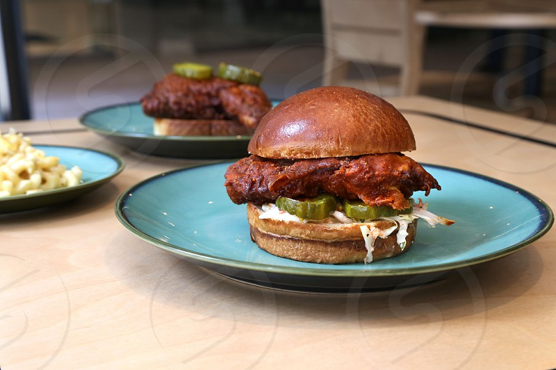 Hot Chicken Sandwich with pickles and cole slaw photo