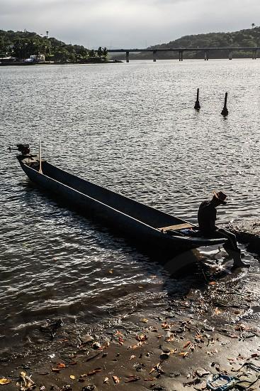 Man sitting in the boat in Ilheus - Brazil photo