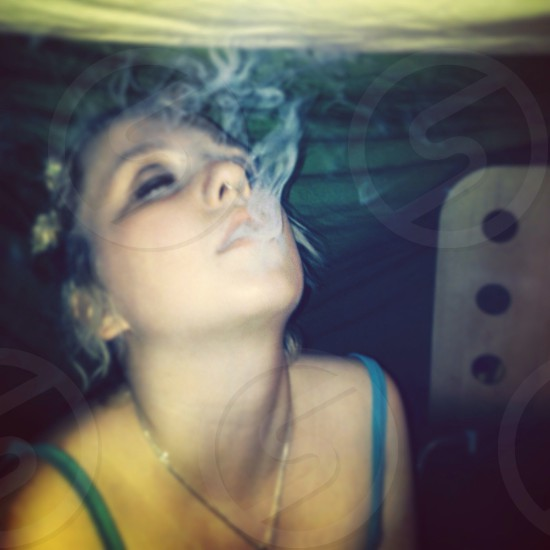 Young woman with smoke.  photo