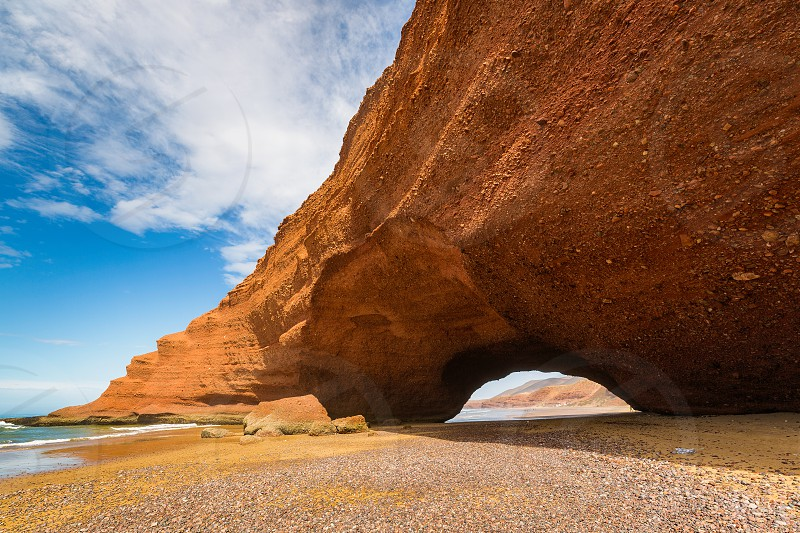 The seaside Legzira in Morocco is known for its famous rock formations. photo