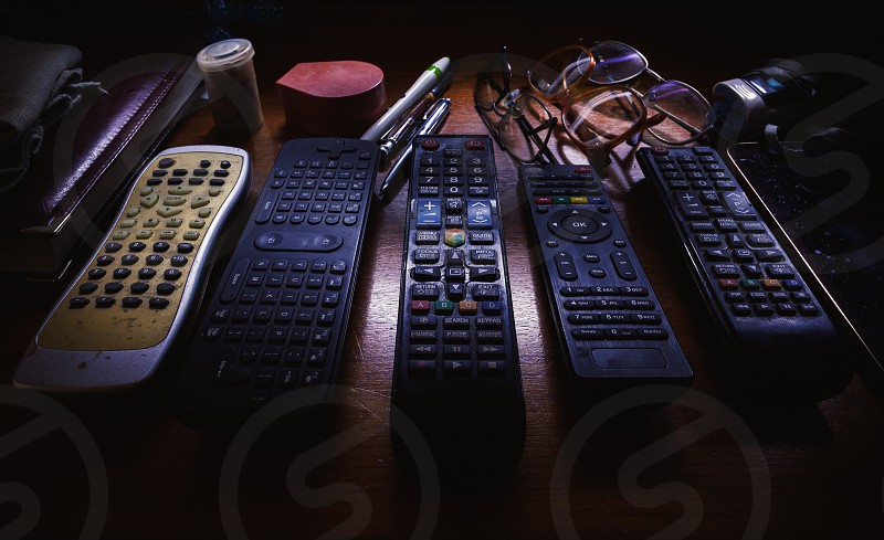 Lifestyle details a lot of used TV remote controllers. photo