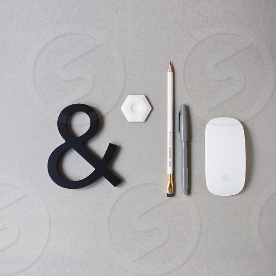Flatlay: Pen pencil eraser mouse ampersand photo