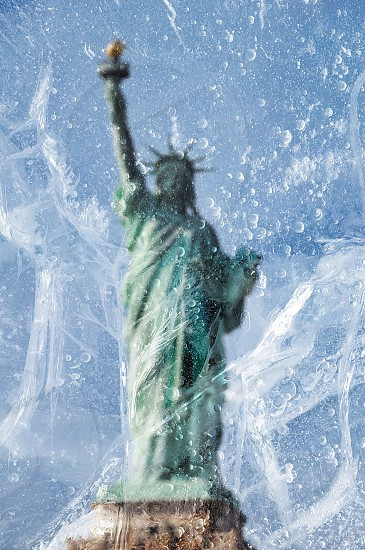 statue of liberty see through from wet glass photo