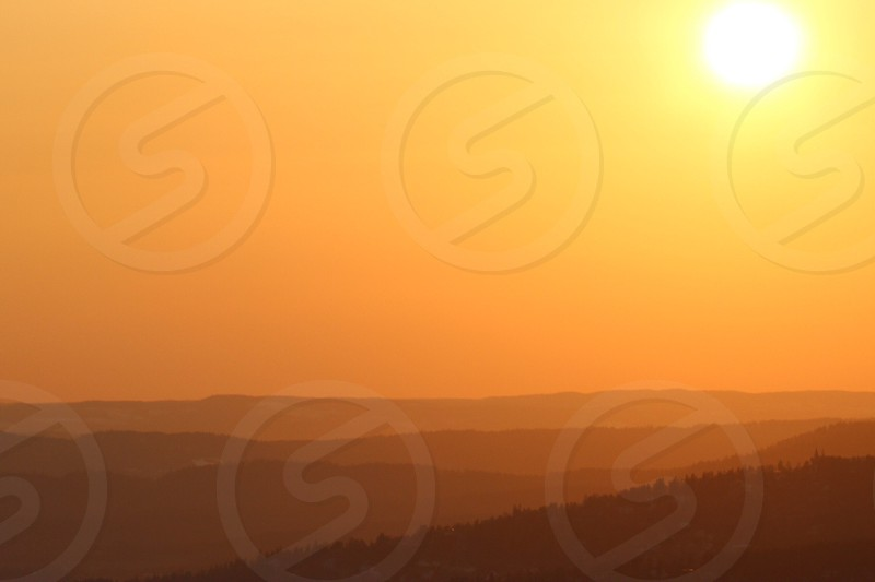landscape of a shining sun and mountains photo