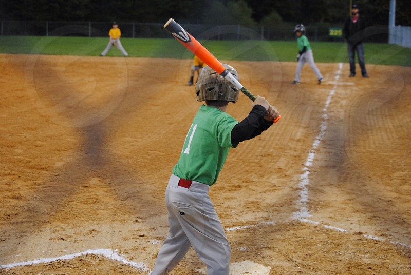 green baseball jersey on game photo