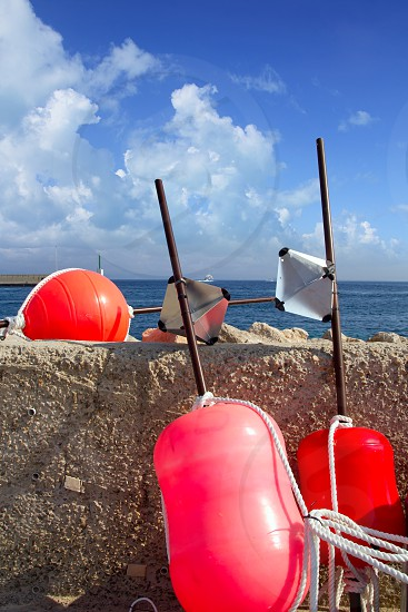 Longliner fisherboat buoy tackle in formentera blue sky photo