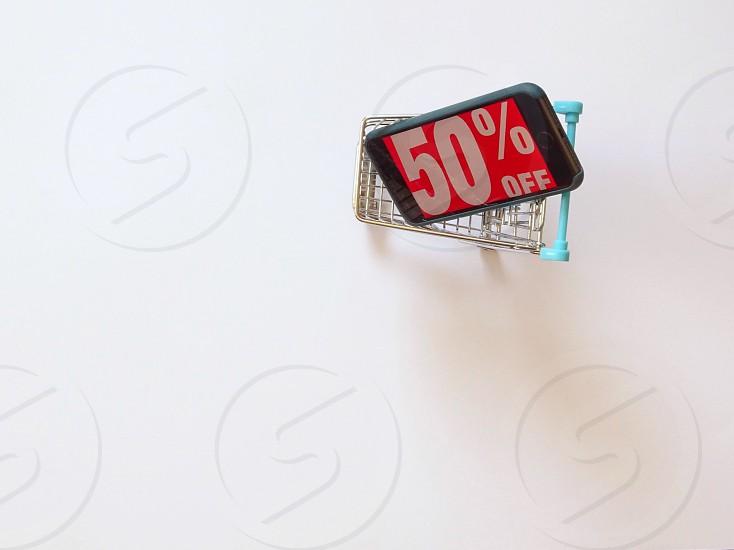 sale50% offwhite backgroundshoppingshopping cartiphonewordtextwordsretailretail shoppingblack fridayonline shopping photo