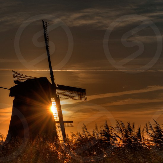 sunrise and wind mill photography  photo