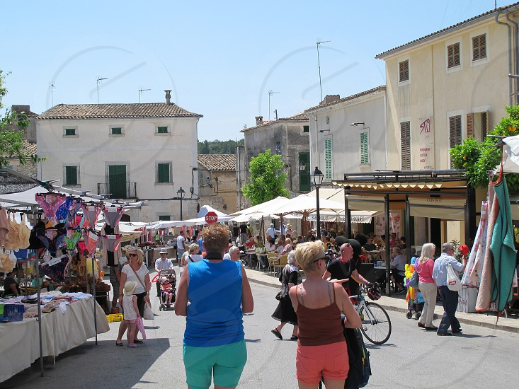 SINEU MALLORCA/ SPAIN June 10 2015: historical town Sineu (Mallorca Spain) with weekly market for local products and cloth. People visiting the market photo