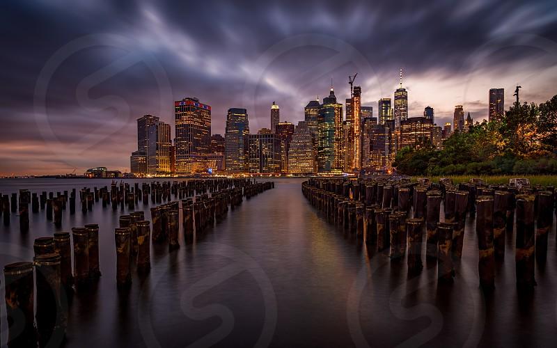 The Manhattan skyline as seen from Brooklyn at night. New York USA. photo