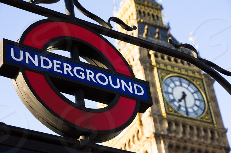Sign of the Underground in London with Big Ben on the background. photo