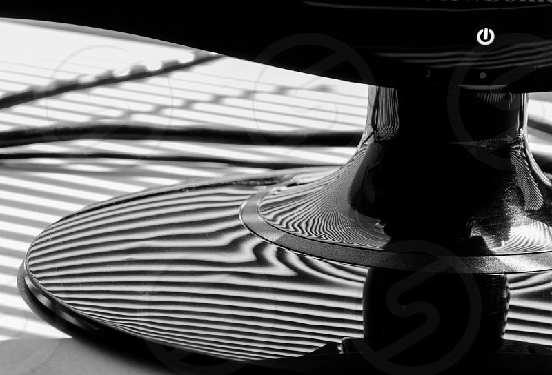 Sunlight through blinds making abstract patterns and stripes on a computer monitor. photo