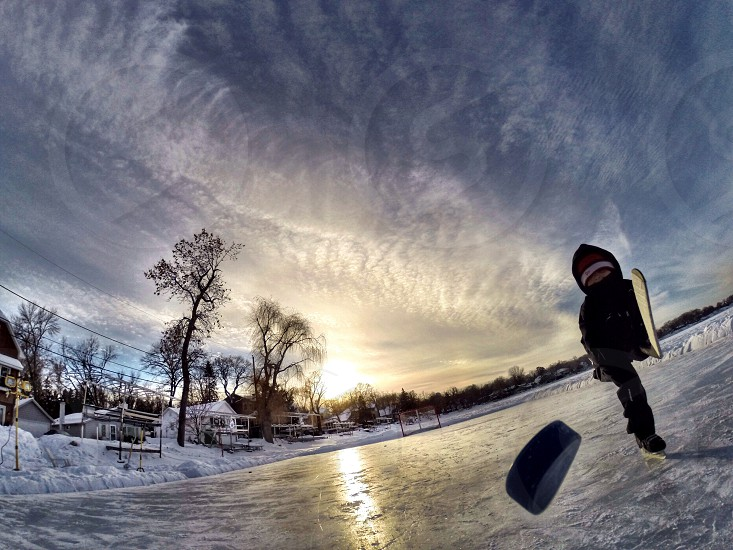 Hockey pond hockey outdoors kids winter Minnesota  photo