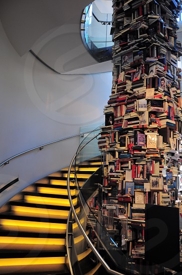 yellow black stairs and books piled photo