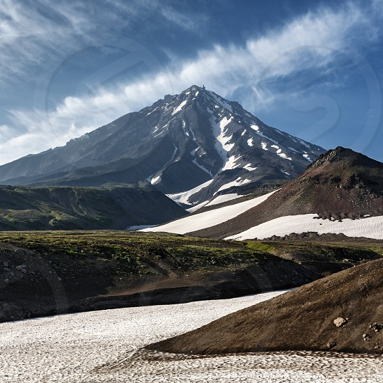 Mountain landscape of Kamchatka Peninsula: scenery view of active volcano Koryakskaya Sopka (Koryak Volcano). Photo majestic rocky cone of stratovolcano photographed from Avacha Pass. Russian Far East photo