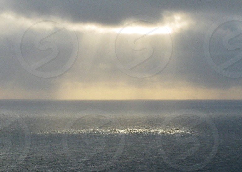 Sunlight glitter Atlantic Sea. photo