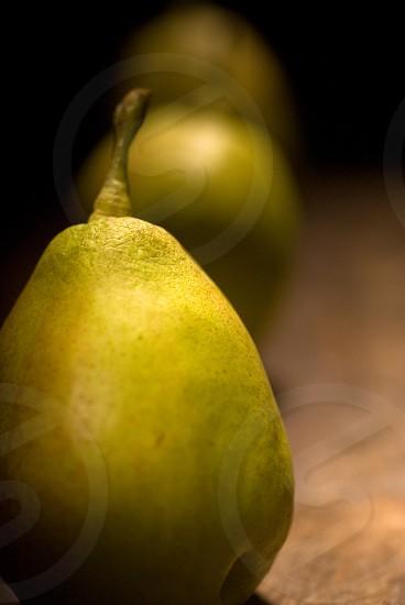 autumn fresh pears over old wood board  photo
