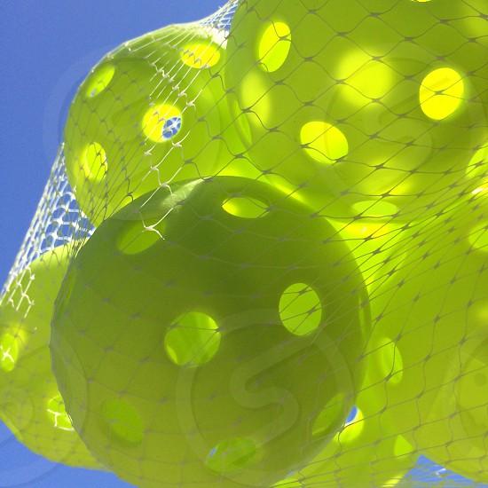 Whiffle plastic bright green balls photo