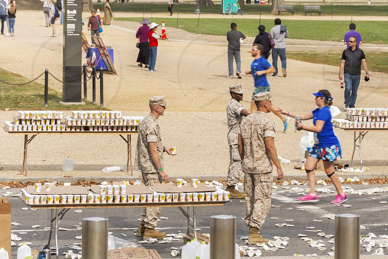 Washington D.C USa october 30 2016: Marines offering refreshment for Runners competing in the Marine Corps Marathon in Washington D.C photo