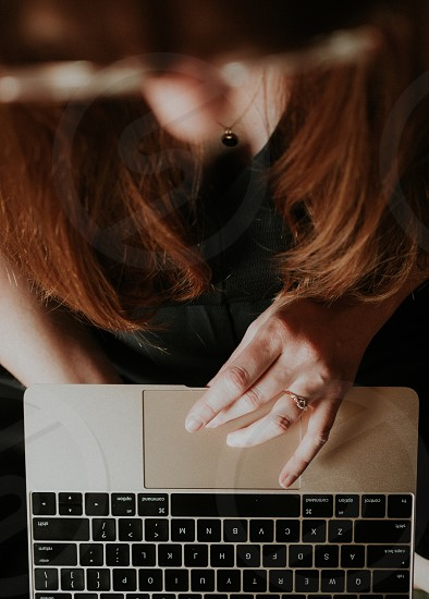 A woman typing on a computer.  photo