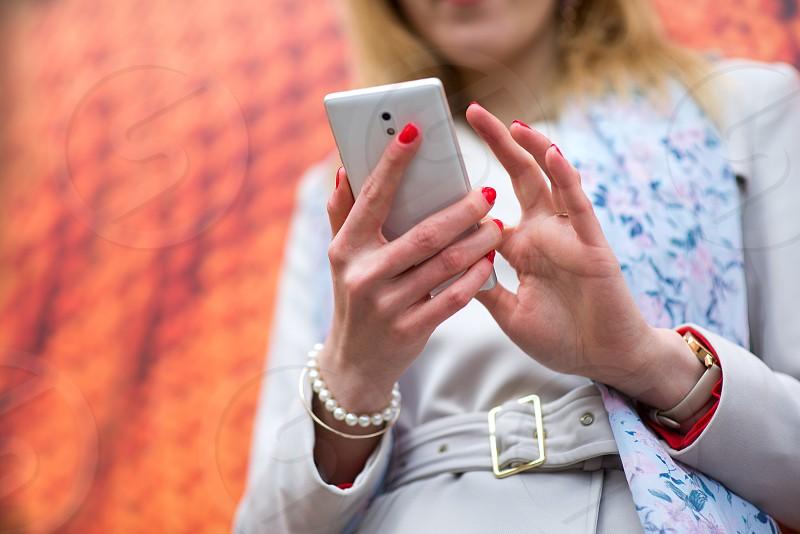 Woman using phone photo
