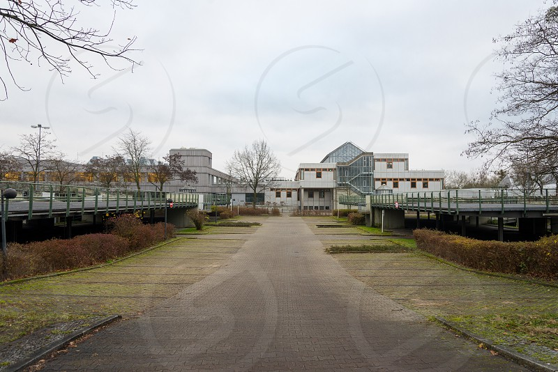 Building and parking area of Freie Universtitat inside Dahlem Neighborhood in Berlin Germany photo