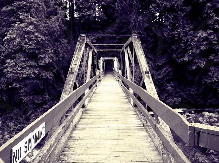 photo of bridge with no swimming sign photo