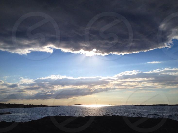 cloudy sky over ocean photo