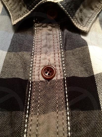black white grey plaid button down shirt brown buttons photo
