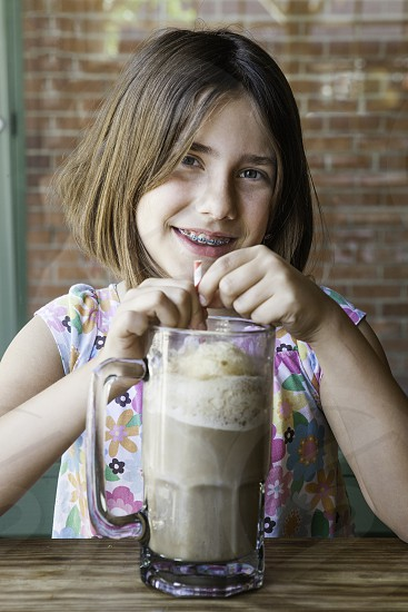 Getting a milk shake at the the soda shop. photo