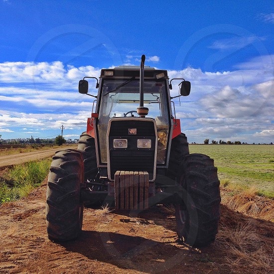 black and red farm tractor photo