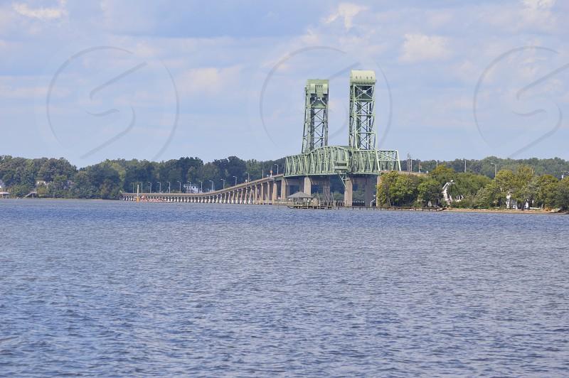 white concrete bridge on water photo