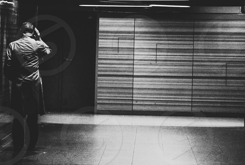 Underground milano atm black and white man alone photo