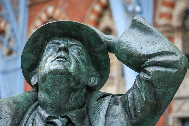 LONDON - DECEMBER 20 : Sir John Betjeman statue on display at St Pancras International Station in London on December 20 2007 photo