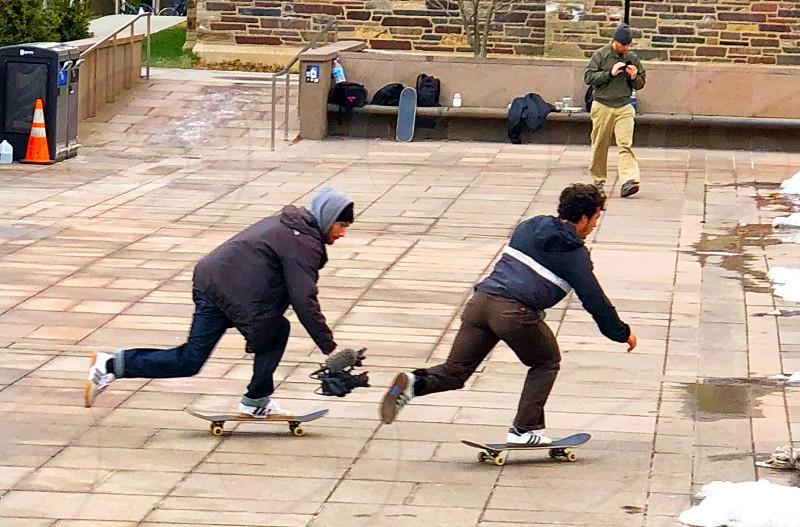 Skateboarder skateboarding athletes sport unison tandem  photo