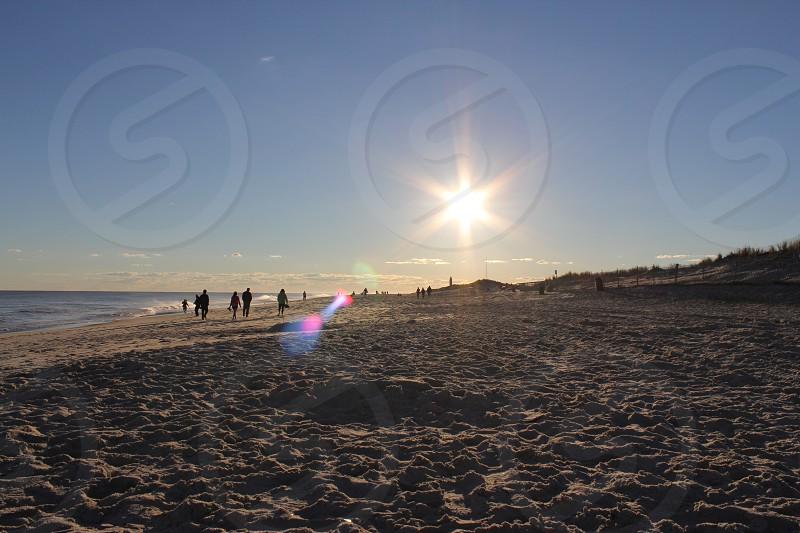 sunset at the beach beach day photo