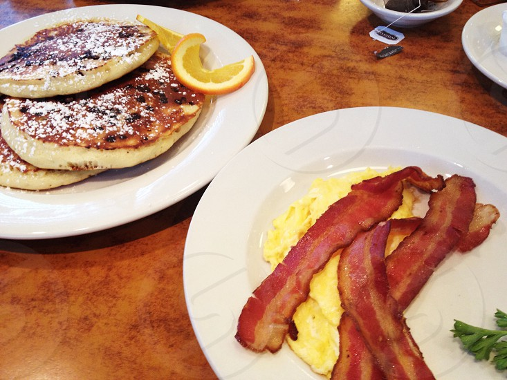 Breakfast food pancakes meal eating bacon eggs chocolate chip pancakes diner scrambled eggs eat photo